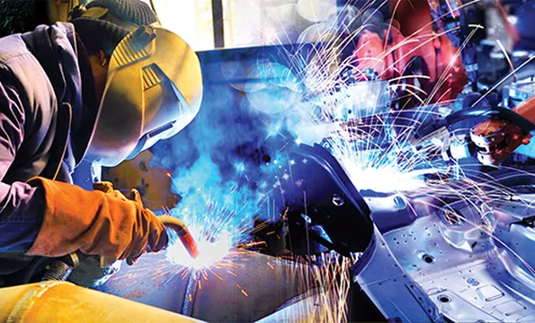 A student welding in class